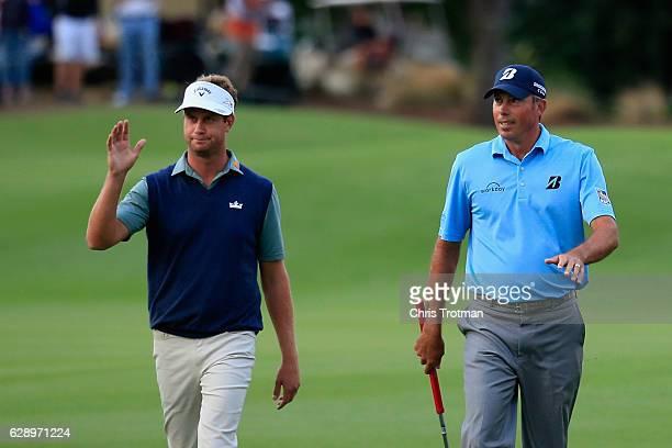 Harris English and his teammate Matt Kuchar walk up the 18th fairway during the final round of the Franklin Templeton Shootout at Tiburon Golf Club...