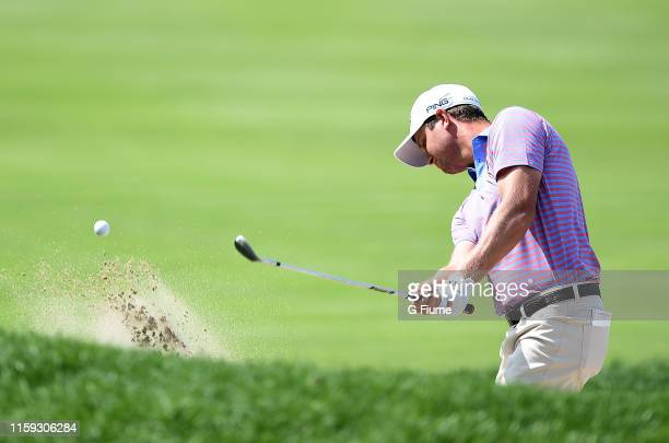 Harris English hits a bunker shot on the seventh hole during the third round of the Travelers Championship at TPC River Highlands on June 22 2019 in...