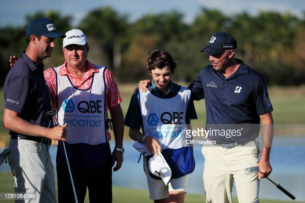 Harris English of the United States, his caddie Eric Larson, and Matt Kuchar of the United and his caddie and son Cameron Kuchar celebrate after...