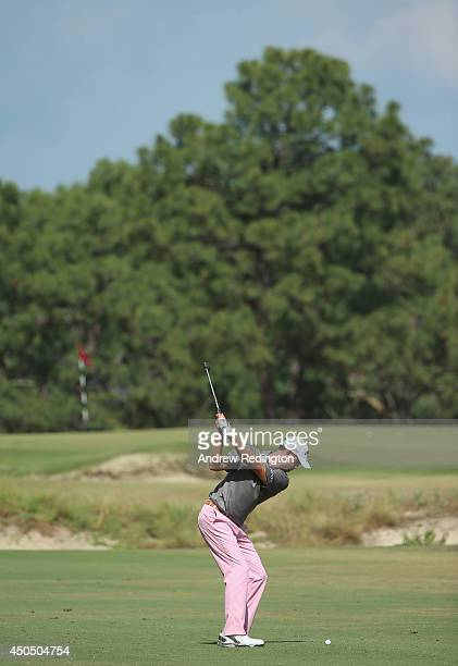 Harris English of the United States hits his second shot on the third hole during the first round of the 114th US Open at Pinehurst Resort Country...