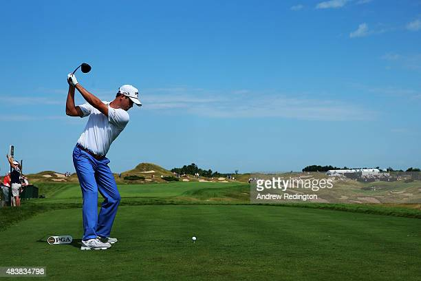 Harris English of the United States hits his tee shot on the 11th hole during the first round of the 2015 PGA Championship at Whistling Straits on...