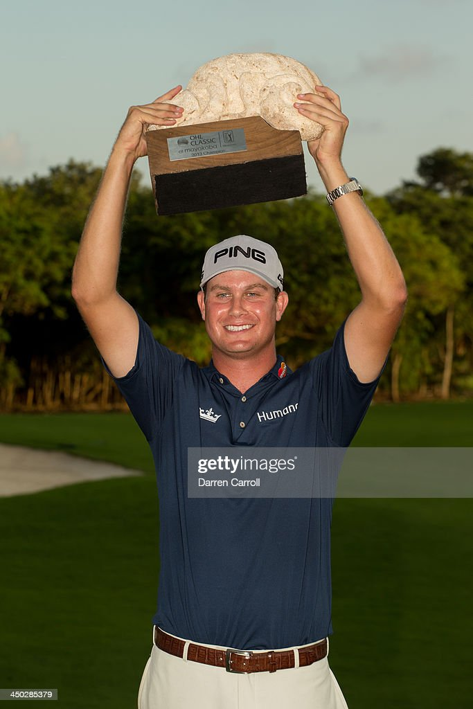 Harris English of the United States holds the champion's trophy after his victory at the 2013 OHL Classic at Mayakoba, played at El Camaleon Golf Club on November 17, 2013 in Playa Del Carmen, Mexico.