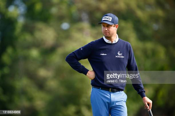 Harris English of the United States looks on from the fourth green during the first round of the 2021 Wells Fargo Championship at Quail Hollow Club...