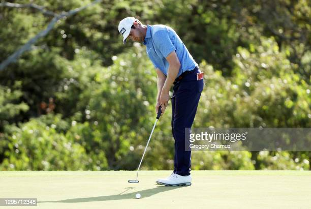 Harris English of the United States makes a putt for birdie on the 18th green to defeat Joaquin Niemann of Chile in a playoff during the final round...
