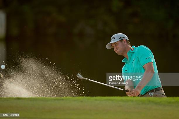 Harris English of the United States plays a bunker shot at the fifth hole during the third round of the 2013 OHL Classic at Mayakoba, played at El...