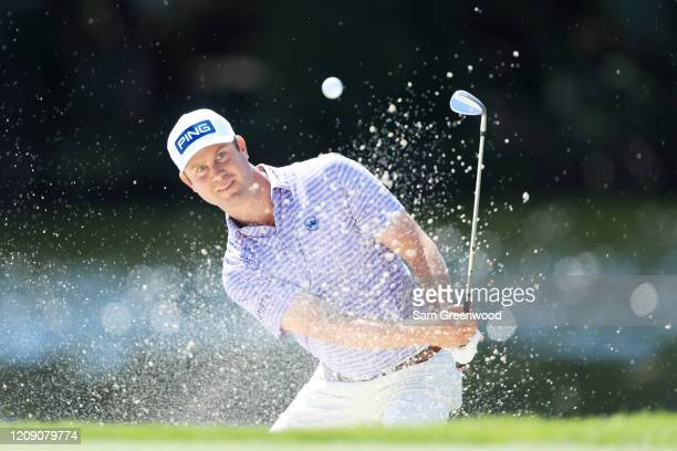 Harris English of the United States plays a shot from a bunker on the sixth hole during the first round of the Honda Classic at PGA National Resort...
