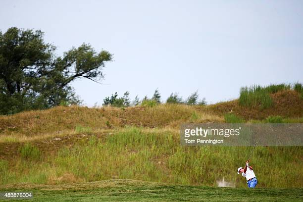 Harris English of the United States plays a shot on the 15th hole during the first round of the 2015 PGA Championship at Whistling Straits on August...