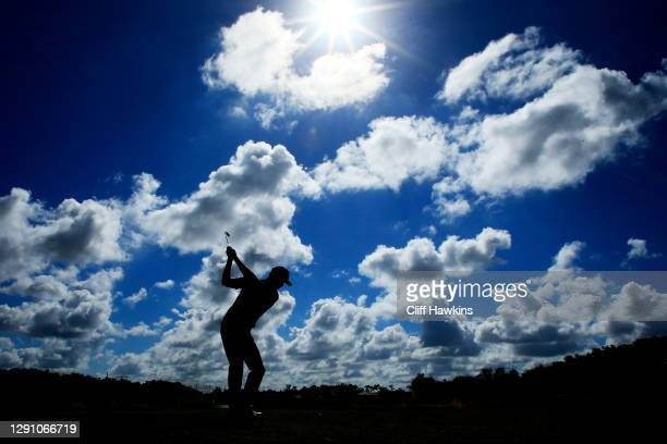 Harris English of the United States plays his shot from the eighth tee during the final round of the QBE Shootout at Tiburon Golf Club on December...