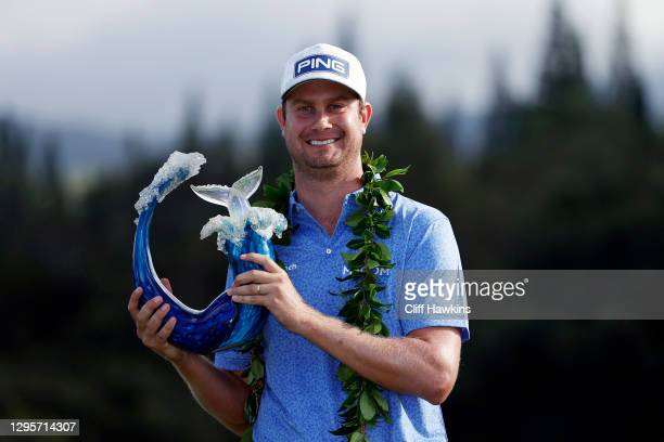 Harris English of the United States poses with the trophy after defeating Joaquin Niemann of Chile in a playoff during the final round of the Sentry...