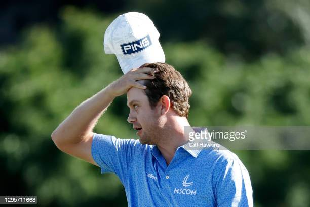 Harris English of the United States reacts after making a putt for birdie on the 18th green to defeat Joaquin Niemann of Chile in a playoff during...