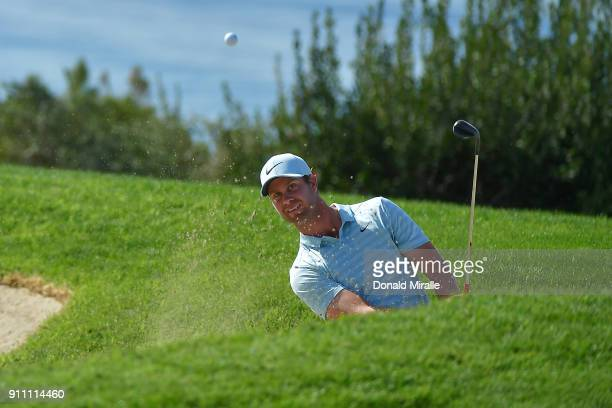 Harris English plays a shot from a bunker on the fourth hole during the third round of the Farmers Insurance Open at Torrey Pines South on January 27...