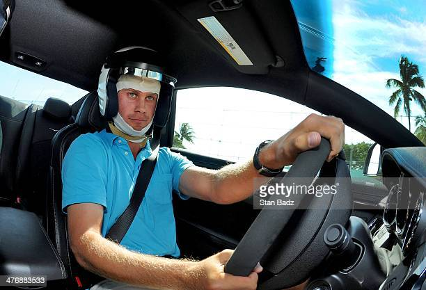 Harris English races car around the track during the Cadillac VSeries Challenge driving experience at the HomesteadMiami Speedway for the World Golf...