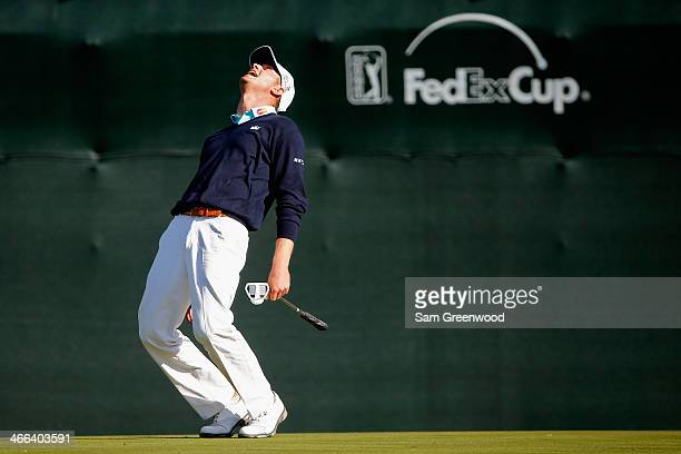 Harris English reacts after missing a putt on the 16th hole during the third round of the Waste Management Phoenix Open at TPC Scottsdale on February...