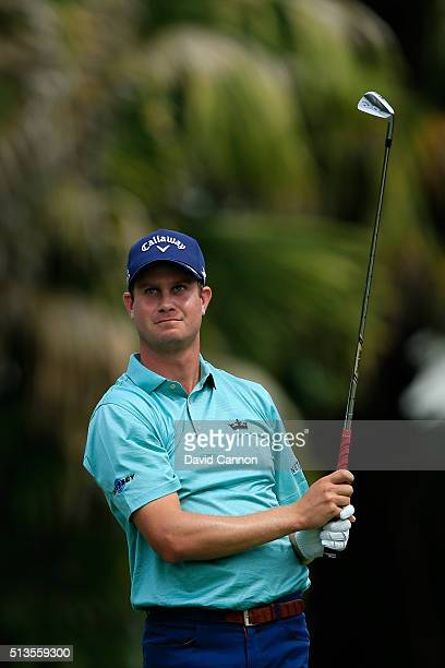 Harris English tees off on the 13th hole during the first round of the World Golf ChampionshipsCadillac Championship at Trump National Doral Blue...