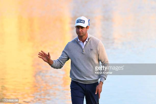 Harris English waves to fans on the 18th hole green during the third round of the Arnold Palmer Invitational presented by MasterCard at Bay Hill Club...