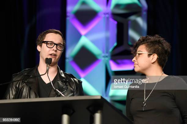 Harris Foster and Jocelyn Reyes accept an award onstage at SXSW Gaming Awards during SXSW at Hilton Austin Downtown on March 17 2018 in Austin Texas