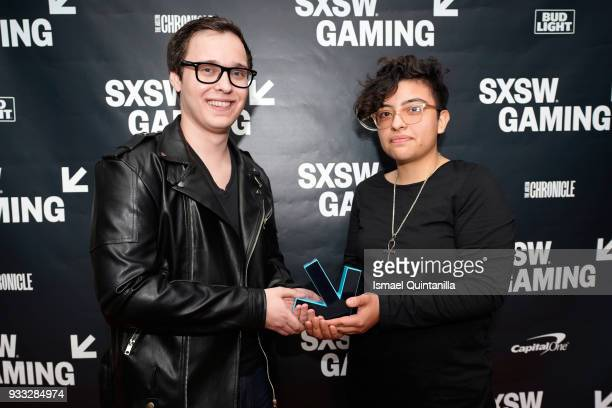 Harris Foster and Jocelyn Reyes pose with their award at SXSW Gaming Awards during SXSW at Hilton Austin Downtown on March 17 2018 in Austin Texas