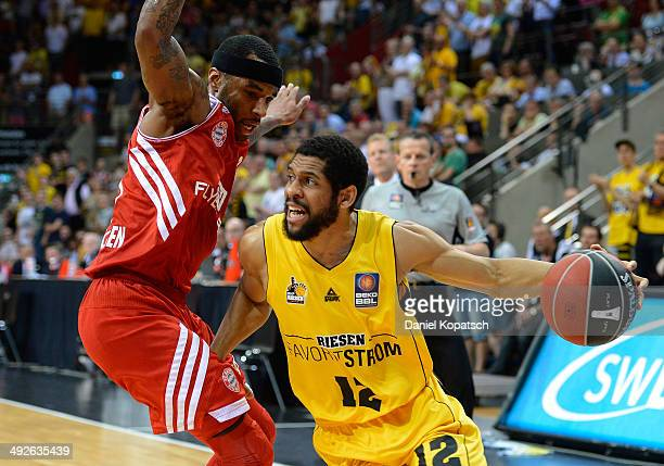 J Harris of Ludwigsburg is challenged by Malcolm Delaney of Muenchen during the Beko BBL Playoffs semifinal match between MHP RIESEN Ludwigsburg and...