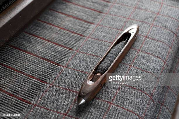 Harris tweed fabric woven on a Hattersley loom at the home of Donald MacDonald, Shawbost village, Isle of Lewis, Outer Hebrides, Scotland on 19 July...