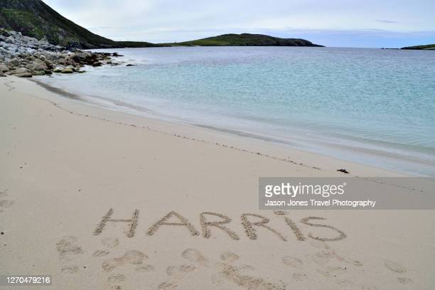 harris written in the sand on a beach in harris - single word stock pictures, royalty-free photos & images