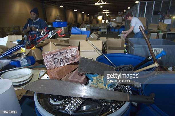 Containers holding items seized by TSA officials from passengers at airports during security screening are seen at the Commonwealth Garage and...