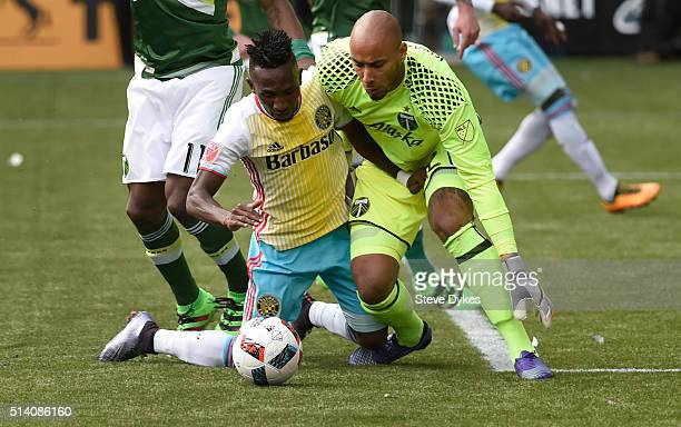 Harrison Afful of Columbus Crew and Adam Larsen Kwarasey of Portland Timbers go after a ball during the second half of the game at Providence Park on...