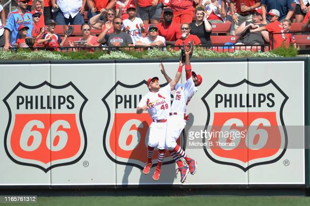Harrison Bader and Dexter Fowler both of the St Louis Cardinals fields a ball in the sixth inning against the San Francisco Giants at Busch Stadium...