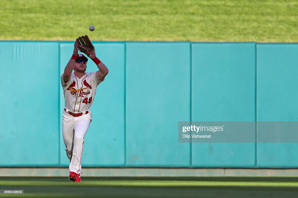 Harrison Bader #48 of the St. Louis Cardinals catches a fly ball against the Milwaukee Brewers in the seventh inning at Busch Stadium on September 30, 2017 in St. Louis, Missouri.