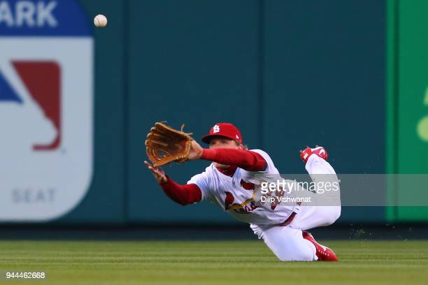 Harrison Bader of the St Louis Cardinals catches a line drive against the Milwaukee Brewers in the first inning at Busch Stadium on April 10 2018 in...