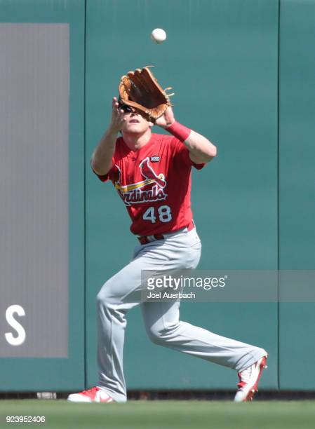 Harrison Bader of the St Louis Cardinals catches the ball hit by Lewis Brinson of the Miami Marlins during the third inning of a spring training game...