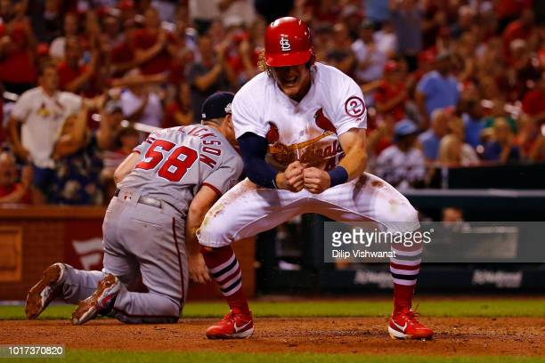 Harrison Bader of the St Louis Cardinals celebrates after scoring a run on a wild pitch against the Washington Nationals in the fifth inning at Busch...