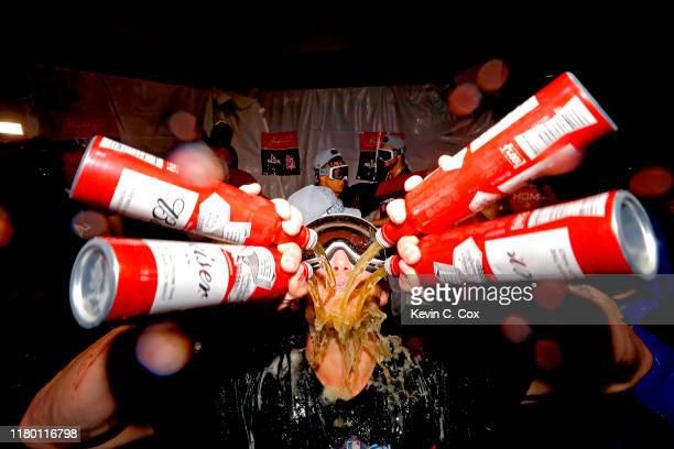 Harrison Bader of the St Louis Cardinals celebrates in the locker room after his teams 131 win over the Atlanta Braves in game five of the National...