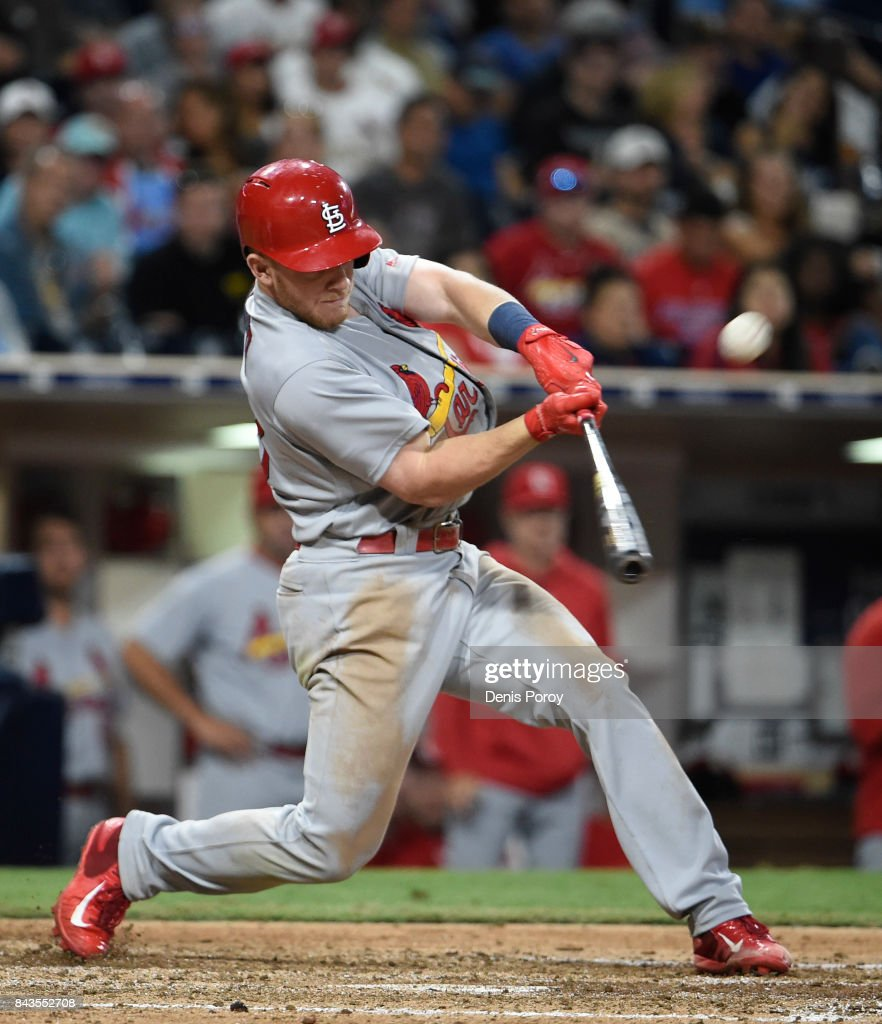 Harrison Bader #48 of the St. Louis Cardinals hits a sacrifice fly during the eighth inning of a baseball game against the San Diego Padres at PETCO Park on September 6, 2017 in San Diego, California.
