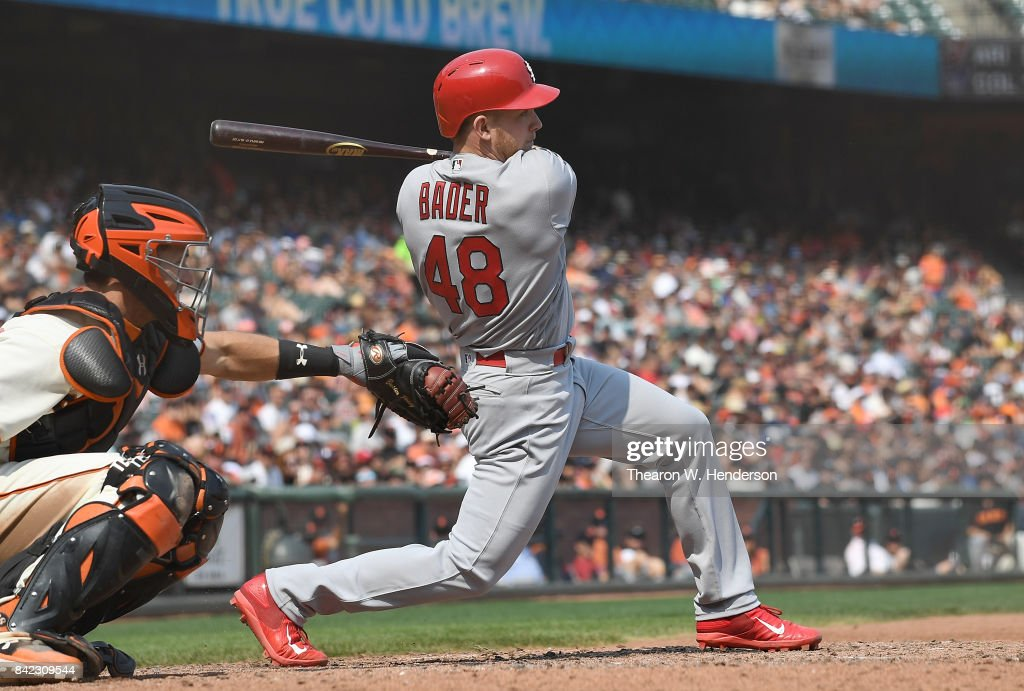 Harrison Bader #48 of the St. Louis Cardinals hits an rbi single scoring Alex Mejia #54 against the San Francisco Giants in the top of the seventh inning at AT&T Park on September 3, 2017 in San Francisco, California.