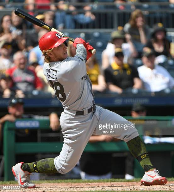 Harrison Bader of the St Louis Cardinals hits an RBI single to right field in the eighth inning during the game against the Pittsburgh Pirates at PNC...