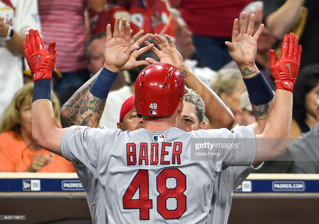 Harrison Bader #48 of the St. Louis Cardinals is congratulated after hitting a three-run home run during the second inning of a baseball game against the San Diego Padres at PETCO Park on September 5, 2017 in San Diego, California.