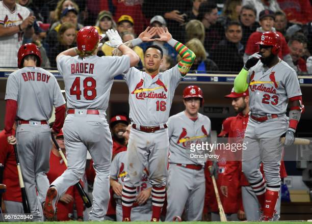 Harrison Bader of the St Louis Cardinals is congratulated by Kolten Wong after hitting a solo home run during the third inning of a baseball game...