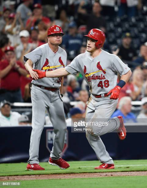 Harrison Bader of the St Louis Cardinals is congratulated by Mike Shildt after hitting a threerun home run during the second inning of a baseball...