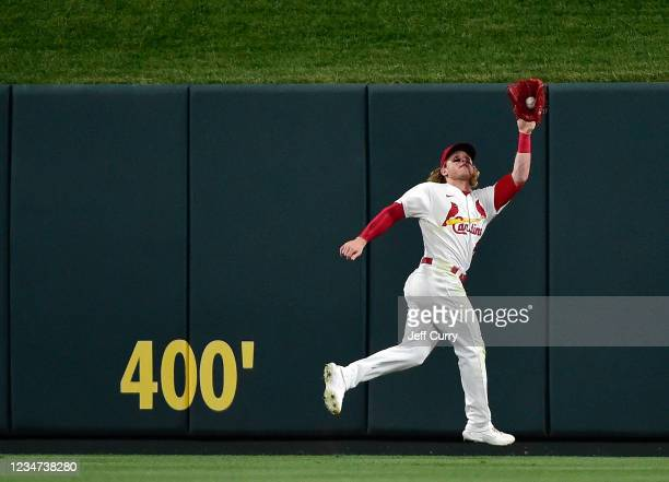 Harrison Bader of the St. Louis Cardinals leaps to catch a line drive in the fifth inning against the Milwaukee Brewers at Busch Stadium on August...