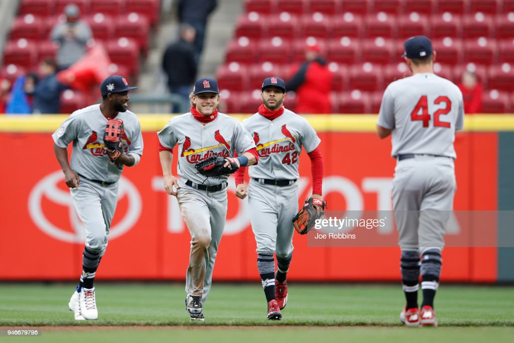 Harrison Bader #48 of the St. Louis Cardinals reacts after catching a line drive for the final out in the ninth inning of the game against the Cincinnati Reds at Great American Ball Park on April 15, 2018 in Cincinnati, Ohio. The Cardinals won 3-2. All players are wearing #42 in honor of Jackie Robinson Day.