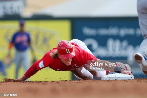 Harrison Bader of the St Louis Cardinals slides safely into second base for a stolen base against the New York Mets during the first inning of a...