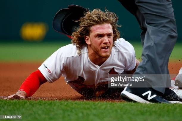 Harrison Bader of the St Louis Cardinals steals third base against the Atlanta Braves in the fourth inning at Busch Stadium on May 26 2019 in St...