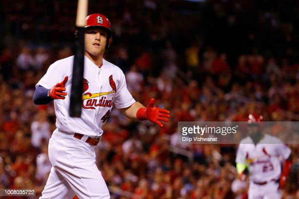 Harrison Bader of the St Louis Cardinals tosses his bat after drawing a walk to drive in a run against the Colorado Rockies in the seventh inning at...