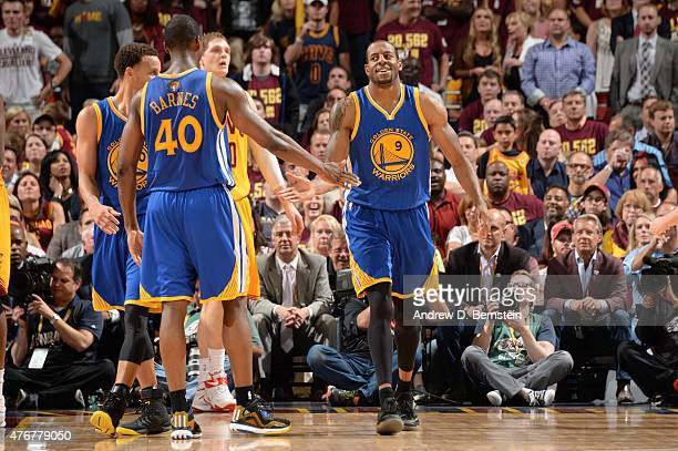 Harrison Barnes and Andre Iguodala of the Golden State Warriors highfive during Game Four of the 2015 NBA Finals at The Quicken Loans Arena on June...