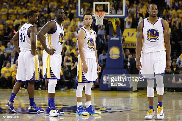 Harrison Barnes Draymond Green Stephen Curry and Andre Iguodala of the Golden State Warriors stand on the court during Game Five of the Western...