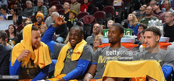 Harrison Barnes Draymond Green Stephen Curry and Klay Thompson of the Golden State Warriors smiles from the bench against the Cleveland Cavaliers on...