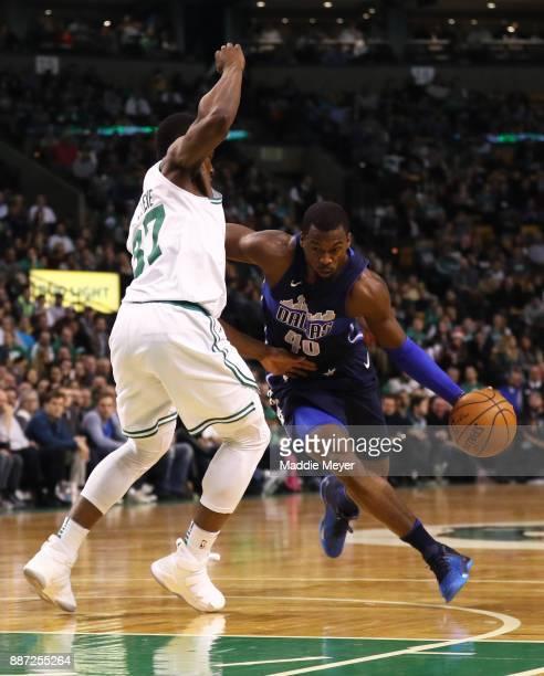 Harrison Barnes of the Dallas Mavericks drives against Semi Ojeleye of the Boston Celtics during the first quarter at TD Garden on December 6 2017 in...