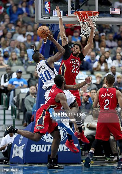 Harrison Barnes of the Dallas Mavericks drives to the basket against Solomon Hill of the New Orleans Pelicans Anthony Davis of the New Orleans...