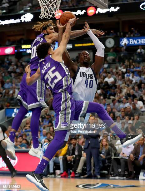 Harrison Barnes of the Dallas Mavericks drives to the basket against Willie Cauley-Stein of the Sacramento Kings and Justin Jackson of the Sacramento...
