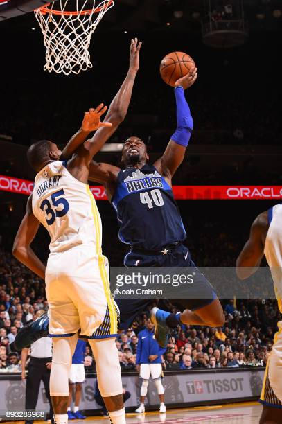 Harrison Barnes of the Dallas Mavericks goes to the basket against the Golden State Warriors on December 14 2017 at ORACLE Arena in Oakland...